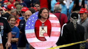 QAnon and Trump supporter at a rally