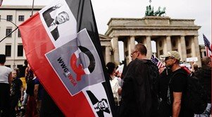 QAnon Flag being waved at a Anti-Lockdown protest in Berlin